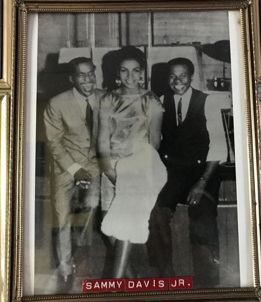 COURTESY: PAUL KNAULS - Legendary entertainer Sammy Davis Jr. (left) shares a laugh with Paul Knauls (right) and his wife, Geneva, who were married nearly 50 years before her death in 2014.