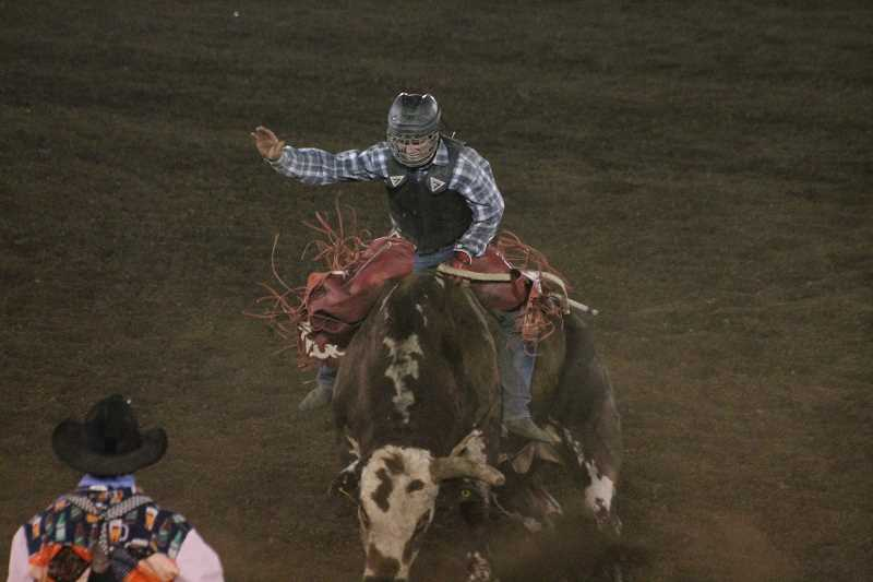 PIONEER PHOTO: CONNER WILLIAMS  - Toby Collins scored 80.5 points Monday night to take third place in the bull riding.