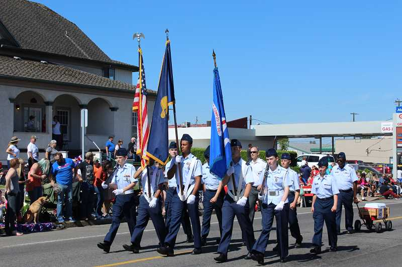 PEGGY SAVAGE - The Honor Guard leads off Molalla's 2017 Fourth of July Giant Street Parade