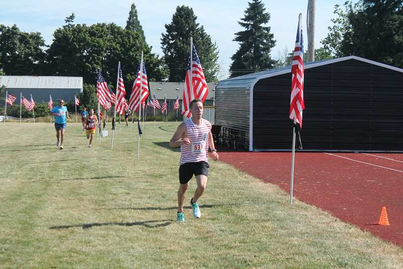 PIONEER PHOTO: CONNER WILLIAMS  - Ethan Bever, 24, of Mulino, took third place overall with a time of 18 minutes, 24 seconds in the sixth annual Freedom 5K race.