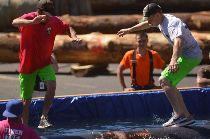ESTACADA NEWS: CLARA HOWELL - Loggers compete in log rolling competition at Timber Festival.