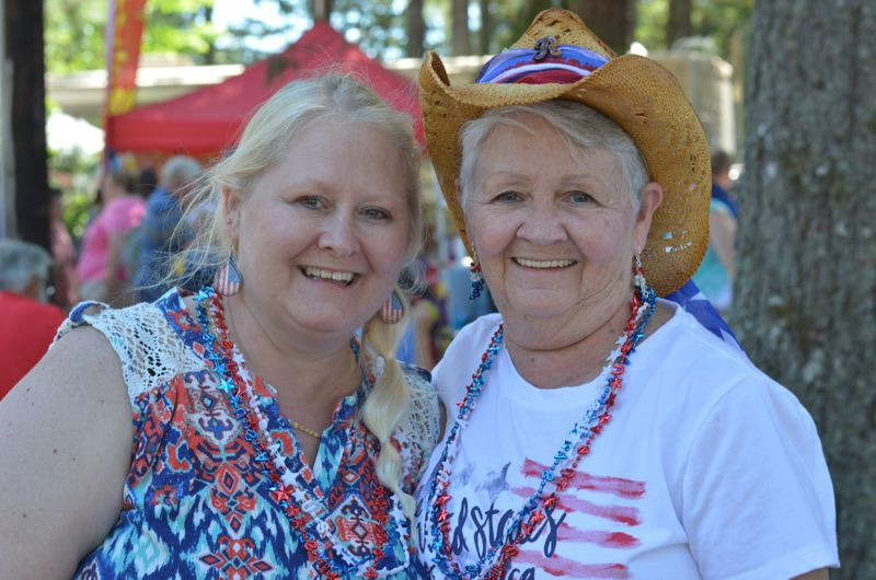 ESTACADA NEWS: CLARA HOWELL - Dawn Rogers (left) and Ruth Rogers (right) have been coming to the Timber Festival for several years to see timber competitions and fireworks.