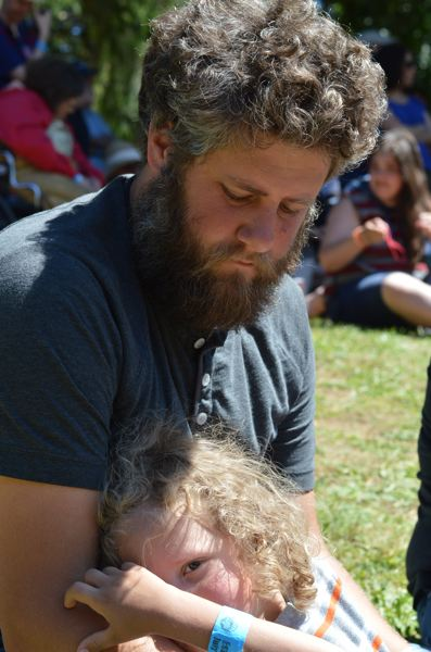 ESTACADA NEWS: CLARA HOWELL - Arlen and his son, Silas, 5, enjoy their first time watching the timber compeitions.