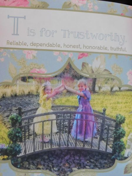 ESTACADA NEWS PHOTO: EMILY LINDSTRAND - The books attribute for the letter T, which BigEagle says is her favorite of all 26 entries, is trustworthy. Princesses Little Bit and Sweet Pea hold hands over a bridge to symbolize the words meaning.
