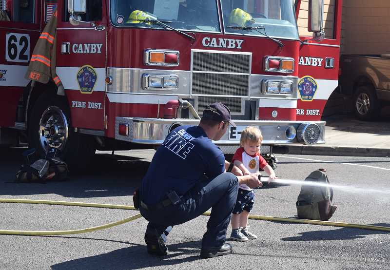 JOHN BAKER - Future firefighter? Who knows? But this little guy had a great time running through the Canby Fire District's obstacle course Tuesday.