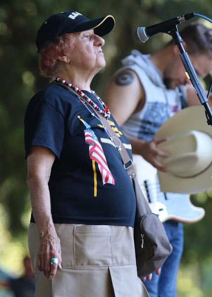 Alice Richmond, the organizer of West Linn's annual Fourth of July event, welcomes the crowd to Willamette Park.