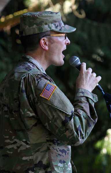 A local National Guard soldier sings the National Anthem at the West Linn July 4th celebration Tuesday.