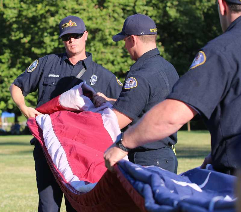 Matt Fehrenbacher was one of four members of the TVF&R crew that were needed to properly fold the flag after it was taken down.