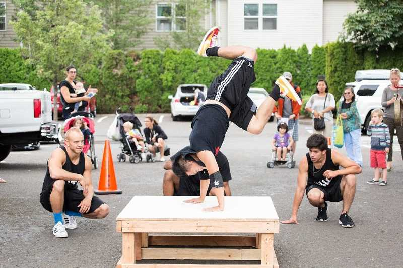 TIMES FILE PHOTO - A break dance crew performs at last year's Ten Tiny Dances event in Beaverton.