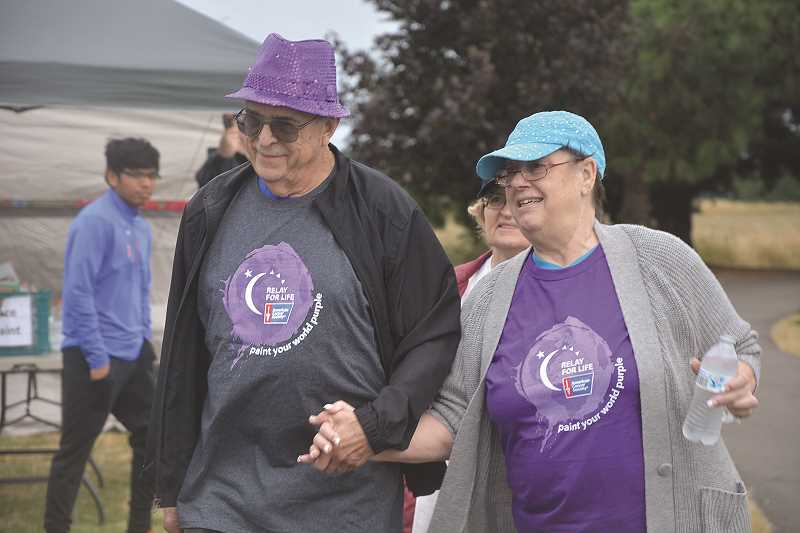 INDEPENDENT FILE PHOTO - Relay for Life of the Woodburn Area always kicks off its event with a survivor lap, pictured.