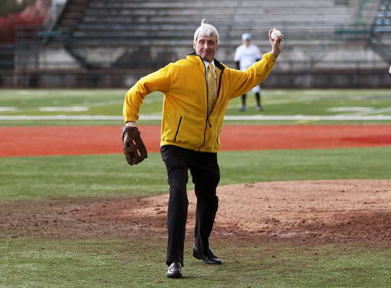 DAN BROOD - Barry Albertson throws out the first pitch at a Tualatin High at Tigard High baseball game in April.