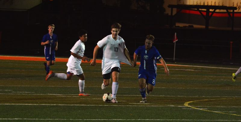 TIMES PHOTO: MATT SINGLEDECKER - Beaverton midfielder Tristan Lewis played both soccer and football for the Beavers this season.