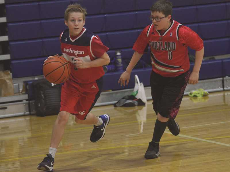 HERALD PHOTO: COREY BUCHANAN - The Canby High boys basketball team hosts summer camp.