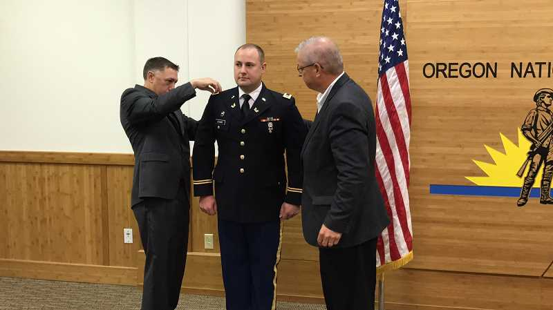 SUBMITTED PHOTO - First Lt. Adams serves the Oregon Army National Guard as a reservist where he drafts wills for deploying service members and advises commanders on a multitude of legal issues.