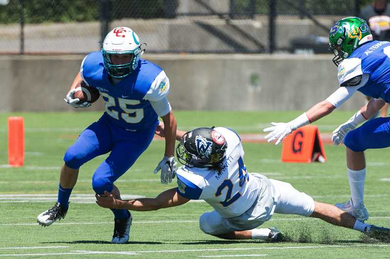 HILLSBORO TRIBUNE PHOTO: CHRISTOPHER OERTELL - Century's Brennan Howell avoids a tackler during the Les Schwab Bowl last weekend. Howell will be playing football at the College of the Siskiyous next fall.