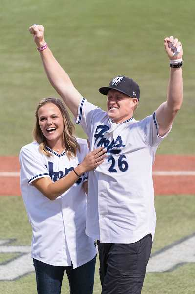 HILLSBORO TRIBUNE PHOTO: CHRISTOPHER OERTELL - Former Hops third baseman Nate Robertson celebrates after popping the question to his girlfriend following singing 'Take me out to the ball game,' during the seventh inning stretch.