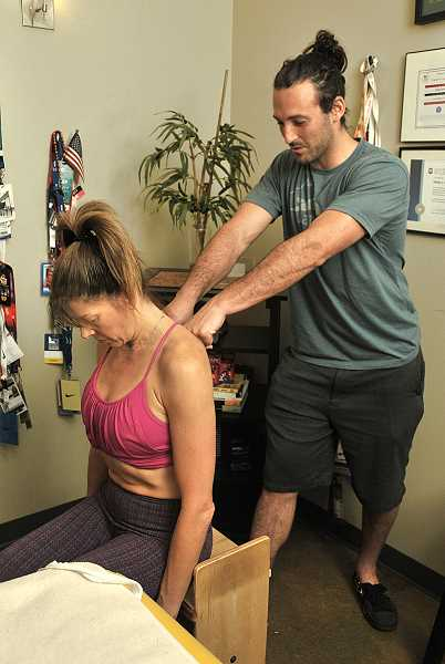 PAMPLIN MEDIA PHOTO: VERN UYETAKE - Jacob Liebman swears by the practice of rolfing, which helped him personally when he was dealing with injuries during his basketball career.