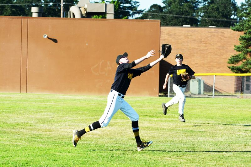 SPOTLIGHT PHOTO: JAKE MCNEAL - Lions pitcher Owen Wolfe chases a pop-up to right field.