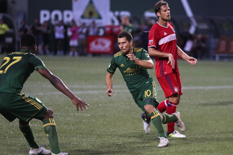 TRIBUNE PHOTO: JAIME VALDEZ - Portland Timbers midfielder Sebastian Blanco (right) celebrates after scoring a goal in the second half against the Chicago Fire at Providence Park.
