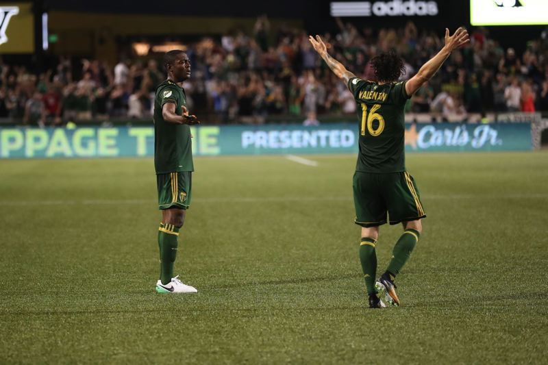 TRIBUNE PHOTO: JAIME VALDEZ - Portland Timbers forward Fanendo Adi (left) and defender Zarek Valentin react after learning that Adi's goal didn't count because of a foul in the second half Chicago Fire at Providence Park.