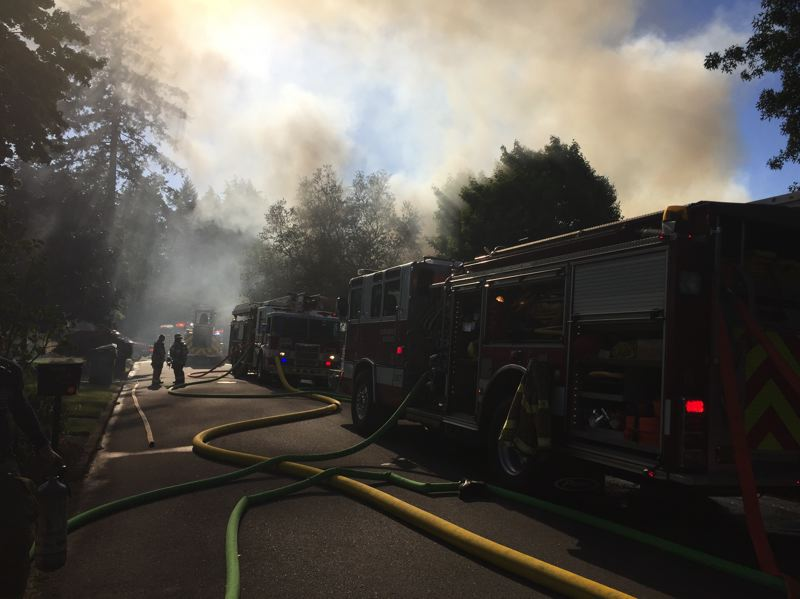 PHOTO: TUALATIN VALLEY FIRE & RESCUE - Crews worked through the afternoon Wednesday, July 5, to extinguish a house fire on Southwest Milburn Street in Beaverton.