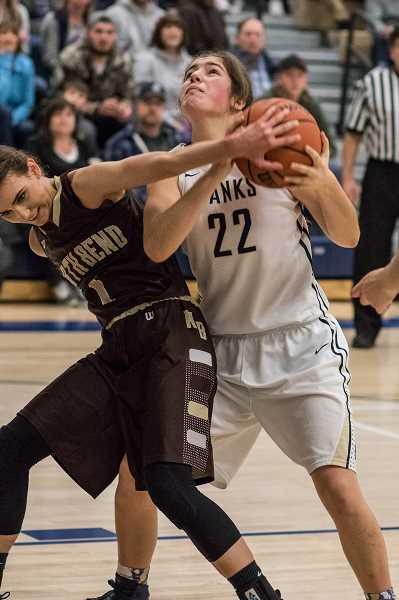 NEWS-TIMES FILE PHOTO: CHASE ALLGOOD - Banks' Sydney Gregg fights for a rebound during the Braves' playoff win over North Bend last season.