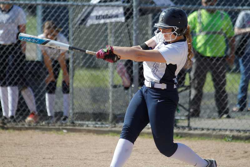 NEWS-TIMES PHOTO: WADE EVANSON - Banks' Mary Schorn takes a swing during the Braves' playoff game with Gladstone earlier this year. Schorn was a standout volleyball and softball player for Banks.
