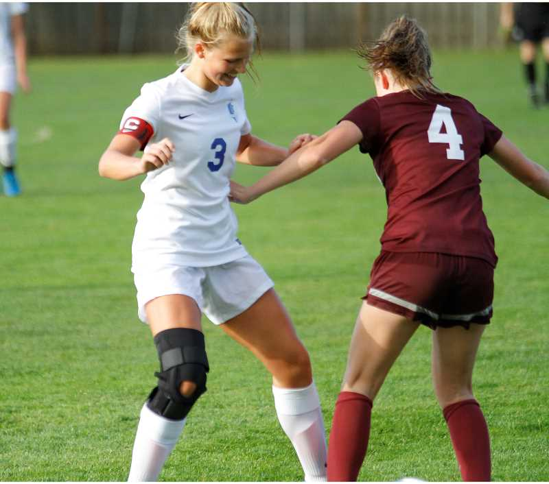 HILLSBORO TRIBUNE FILE PHOTO: CHASE ALLGOOD - Hilhi's Kennedy Taube attacks a defender during a soccer game last season.
