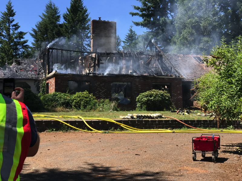 CONTRIBUTED PHOTO: CLACKAMAS FIRE DISTRICT NO. 1 - The front of the 302-Lane home after the flames were out.