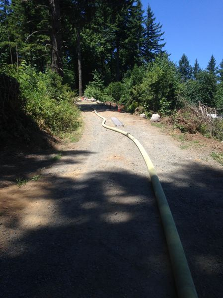 CONTRIBUTED PHOTO: CLACKAMAS COUNTY FIRE DITRICT NO. 1 - Firefighters had to lay 2,000 feet of hose and pump uphill to supply water to the site.