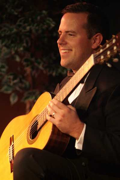 SUBMITTED PHOTO  - William Jenks, Marylhurst guitar instructor and proprietor of Portland Classic Guitar, will perform July 14 at the Summer on the Green concert.