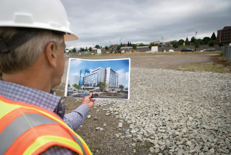 PAMPLIN MEDIA GROUP: JAIME VALDEZ - Barry Cain, CEO of Gramor Development, shows where a hotel, condo and retail development will stand, just one of dozens slated for the Vancouver waterfront just west of the I-5 bridge.