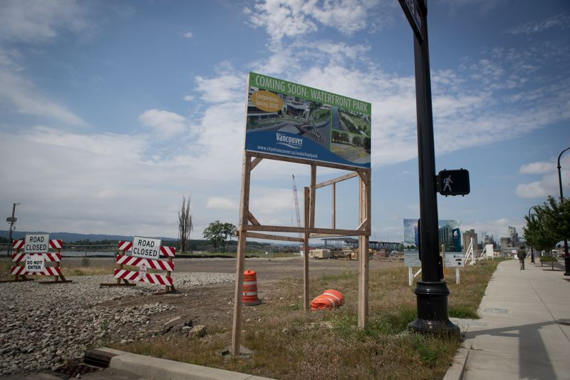 PAMPLIN MEDIA GROUP: JAIME VALDEZ - A sign shows where the Indigo Hotel will sit. Developers expect the site to attract a mixture of empty nesters and Millennials, as well as conventioneers and corporate satellite offices.