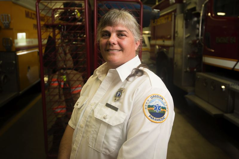 OUTLOOK PHOTO: JOSH KULLA - Tessie Adams, 46, was named Oregon's Volunteer Firefighter of the Year during a ceremony this June.