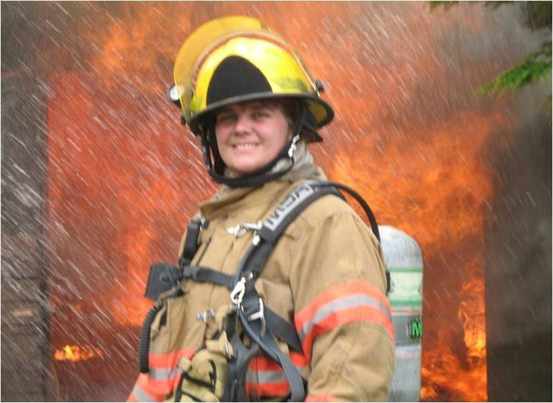 CONTRIBUTED PHOTO - Capt. Adams poses for a picture during a controlled training burn for Corbett firefighters.