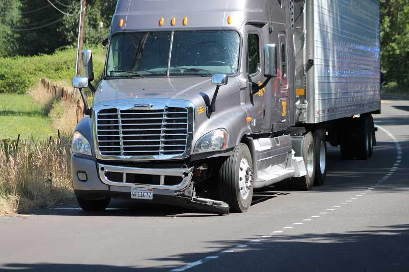 PIONEER PHOTO: CONNER WILLIAMS - The semi-truck appears to have suffered some significant damage in the crash as well.