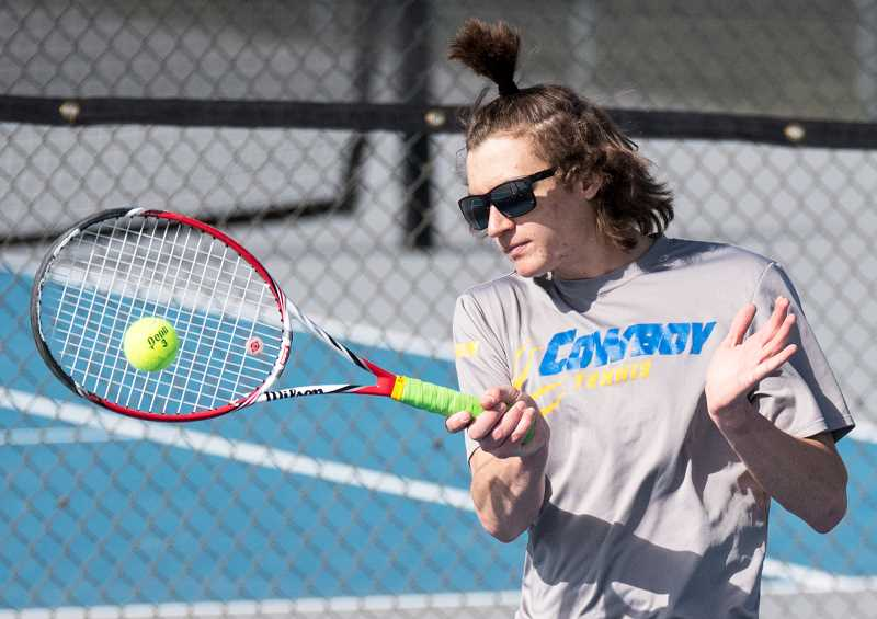 LON AUSTIN/CENTRAL OREGONIAN - Cayden Quinn was the Cowboys' No. 1 singles player this past year. The senior just missed qualifying for the state tournament and is one of a large group of Cowboys who graduate this year.