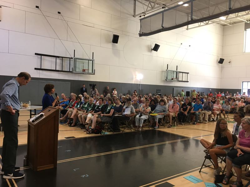PAMPLIN MEDIA GROUP: PETER WONG - U.S. Rep. Suzanne Bonamici responds to a question at a town hall meeting Thursday, July 6, in Beaverton as U.S. Sen. Ron Wyden contemplates his answer. Both are Oregon Democrats.