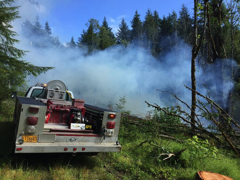 COLUMBIA RIVER FIRE AND RESCUE PHOTO - Columbia River Fire and Rescue personnel respond to brush fire on Anliker Road on Wednesday, June 28. While crews remained on scene for several hours to make sure the blaze was extinguished, no injuries or damages were reported.