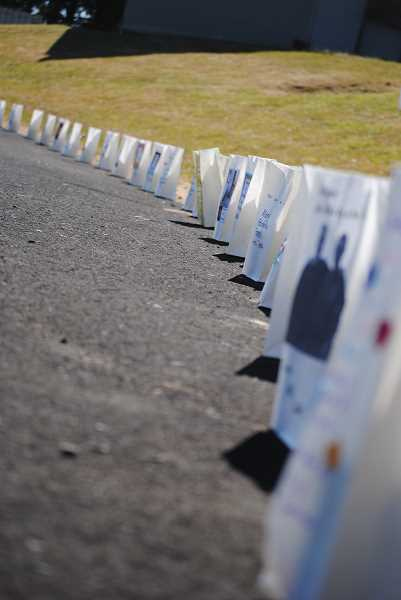 Memorial luminaries line the track at Tom McCall Upper Elementary School During this years Relay for Life, waiting to be lit later that night.