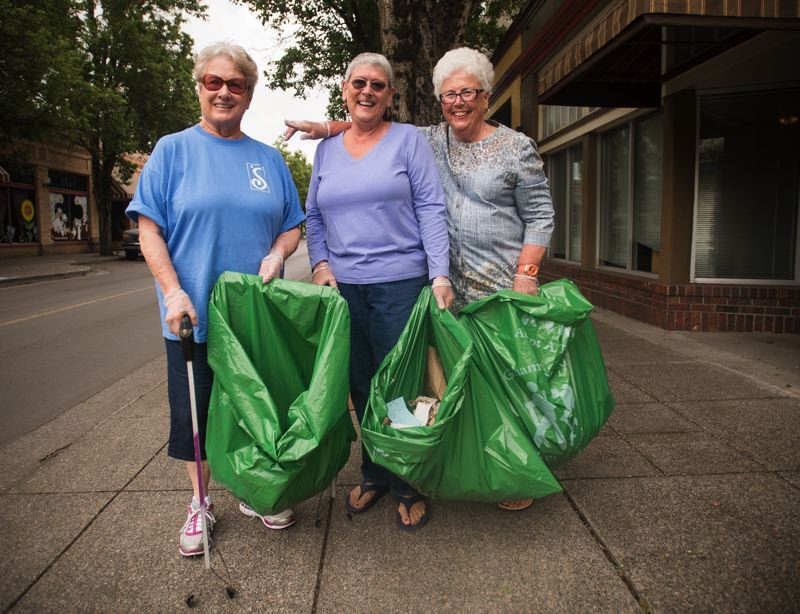 OUTLOOK PHOTO: JOSH KULLA - From left, Carol Nielsen, Leslie Radke and Dorothy Douglas do a little community service three days a week, picking up trash along city streets during their early morning walk.