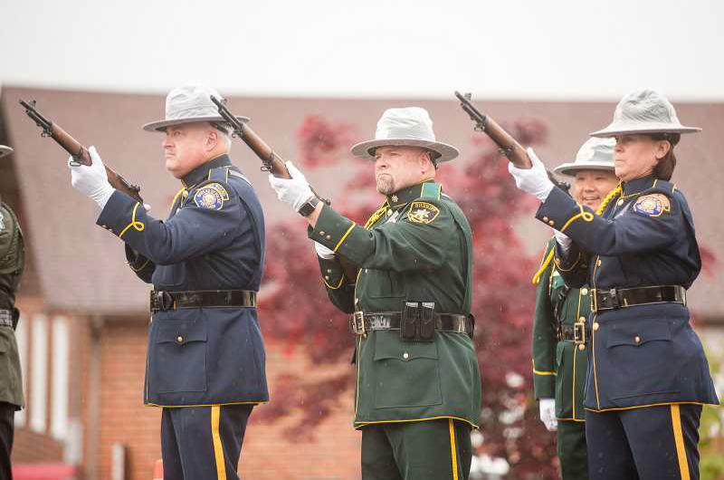 FILE PHOTO - An MCSO ceremonial guard fires a volley of shots.
