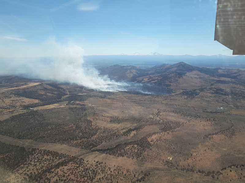 PHOTO COURTESY OF CENTRAL OREGON INTERAGENCY DISPATCH - An aerial view of the Lone Pine Fire on Sunday afternoon.