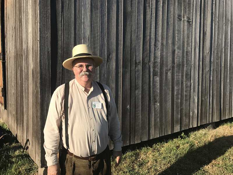 SPOKESMAN PHOTO: MADISON STATEN - Richard Cassidy stands beside the historic barn at the dance.