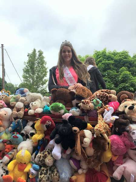 SUBMITTED PHOTO - Ingle with donated stuffed animals from West Linn residents at the 2017 Teddy Bear Parade in Oregon City.