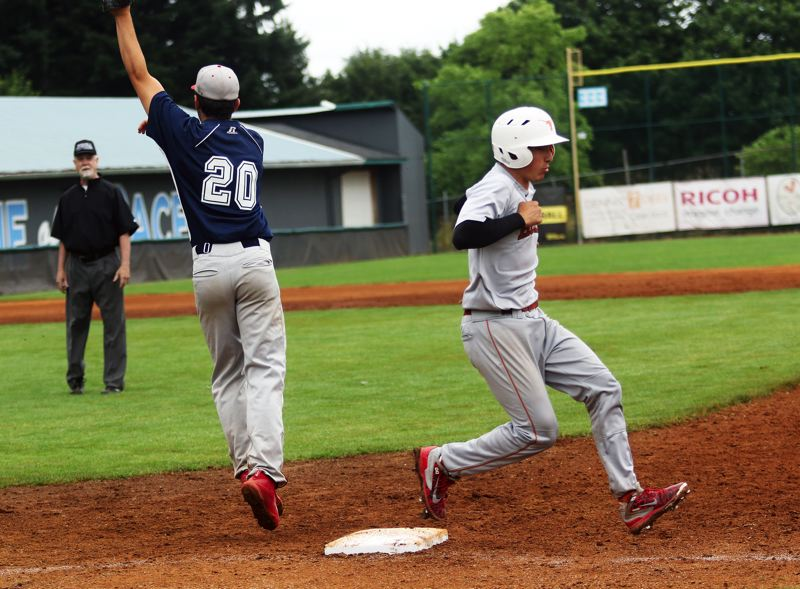 DAN BROOD - Tigard's Joey Cavalli (right) is safe at first base on an infield single in Saturday's game.