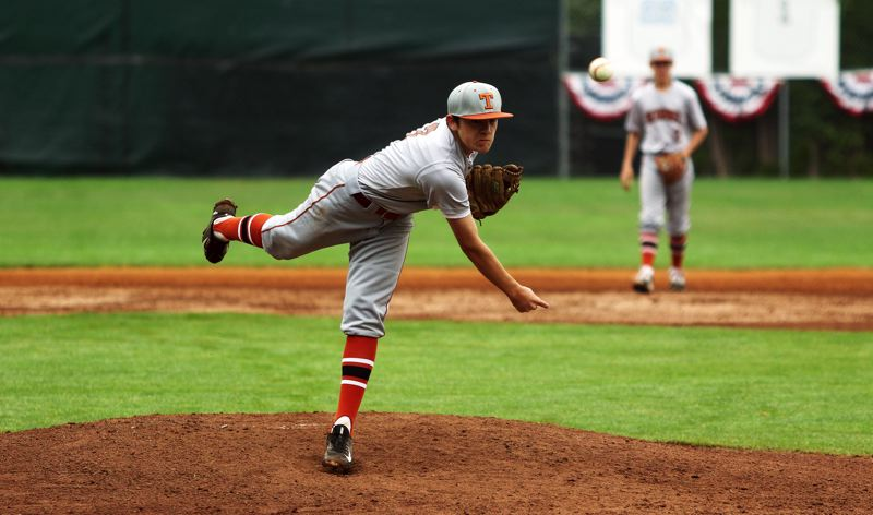 DAN BROOD - Lance Kreisberg fires in a pitch during Saturday's game at the Lakeridge Firecracker Classic.