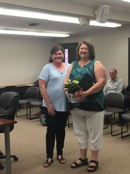 SPOTLIGHT PHOTO: NICOLE THILL - Jennifer Bartocci (left) helps recognize Monica Cade, director of the Retired Senior Volunteer Program, for her work with the St. Helens School District.