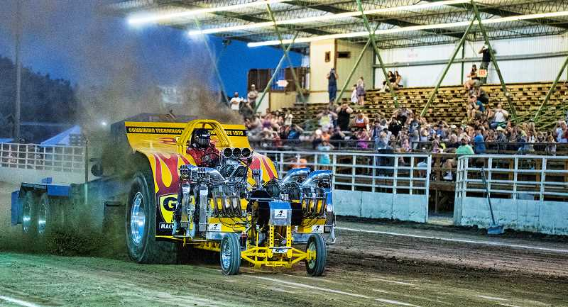 LON AUSTIN/CENTRAL OREGONIAN - Gary Sytsma drives his multi-engine tractor on a full pull on Friday night. Sytsma won the multi-engine portion of the event with a pull of 475.73 feet.