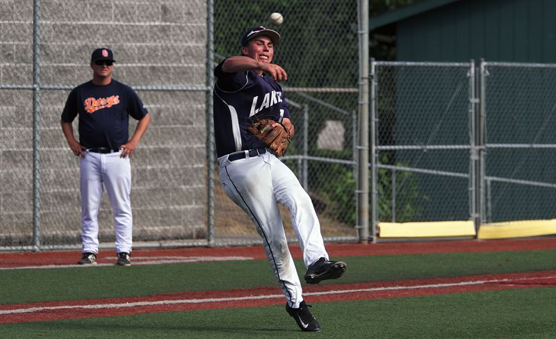 REVIEW PHOTO: MILES VANCE - Lake Oswego third baseman Jackson Laurent throws to first after making a barehanded pickup in his team's 8-0 win over Tualatin in OIBA play on Monday at Lake Oswego High School.